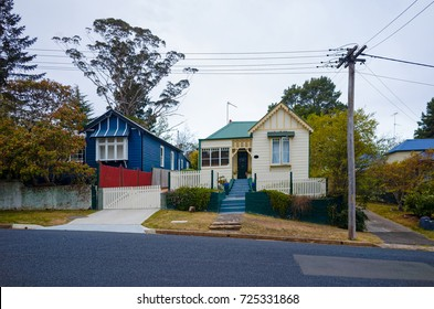 Old picturesque wooden houses in a green Australian suburb. Village street in a small town in New South Wales Australia with historic weatherboard buildings.