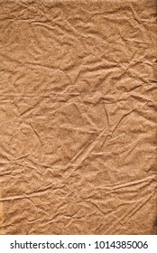 Old piece of wrinkled brown paper creates a textured background. This is a high resolution scan of the paper which shows all the detail.