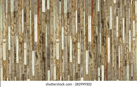 old pieces of wood plank arranged as a big wooden wall