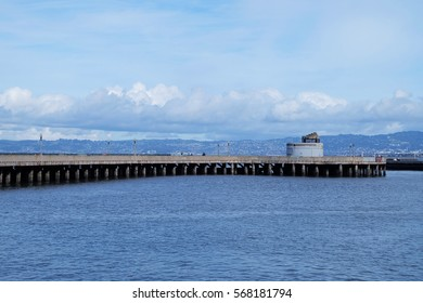 An old pier as a part of Fort Mason with beautiful cloudy sky in the background San Francisco, United States