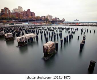 Old pier pillars in Brooklyn, New York