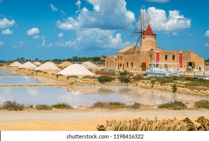 "Old pier and windmill at the natural reserve of the ""Saline dello Stagnone"" near Marsala and Trapani, Sicily."