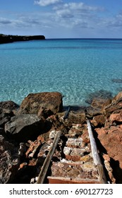 Old pier,Formentera, Balearic Islands, blue sea,Mediterranean sea, favorite destination of foreign tourists in Spain