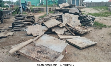 Old pile of square wooden slabs on a floor