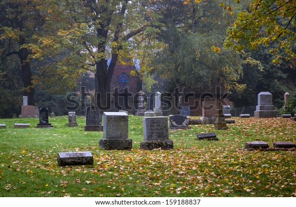 Old Pioneer Cemetery and headstones in fog