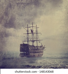 Old pirate ship in the sea. Fine art image with golden and canvas texture added.