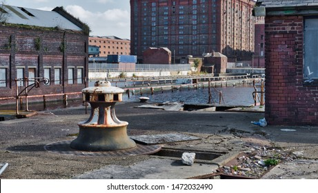 Old Pirate Type dock bollard in Liverpool and Merseyside docks that sailing ships use to tie up to against the dock wall to keep them from moving will goods where unloaded