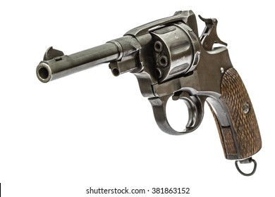 Old pistol with the hammer cocked, isolated on white background