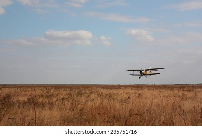 The old plane against the cloudy sky