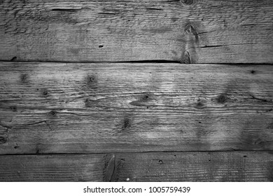 Old plank wooden wall background. The texture of old wood. Weathered piece of wood. Image includes a effect the black and white tones.