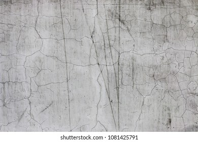 old plaster wall with cracks
