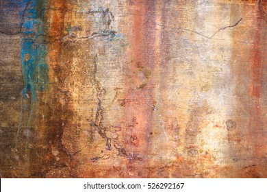 old plaster wall with stains from water and cracks