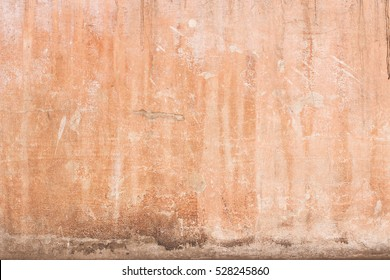 old plastered wall with spots from water