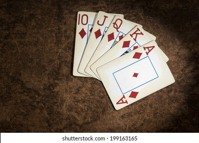 old playing cards collected from a combination of poker royal flush