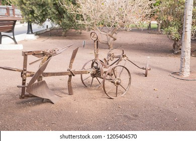 Old plow in a park.