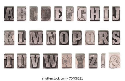 Old plumb letters which were used to print newspapers in the past.