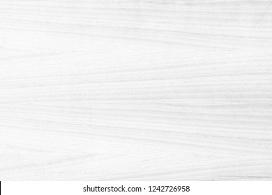 Old plywood textured wooden background or wood surface of the bright white at grunge dark grain wall texture of panel top view. Vintage teak surface board at desk  texture with light pattern natural.