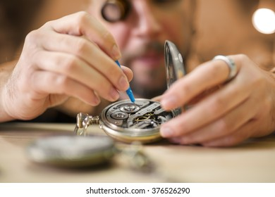 Old pocket watch being repaired by watch maker