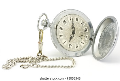 Old pocket watch with chain on white background.
