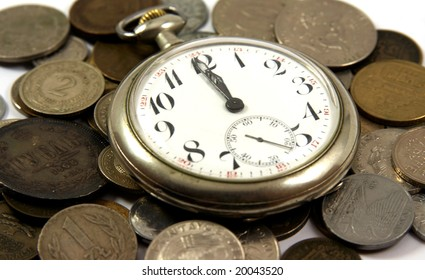 Old pocket watch on the coins of different countries
