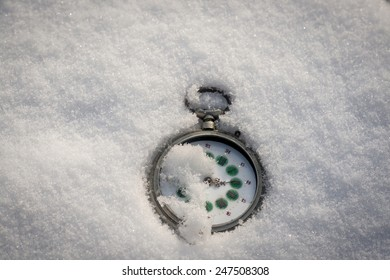 old pocket watch on the snow