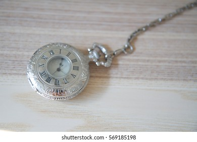 old pocket watch on stone