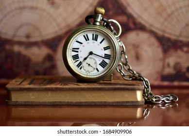 Old pocket watch on a table