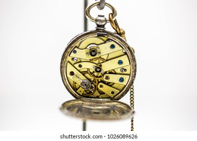 Old Pocket Watch on White Background  Antique golden pocket watch on white background. Concept of time.