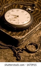 old pocket watch on a old worn book