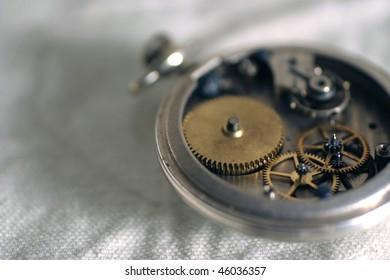 Old pocket watch showing gears