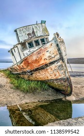 The old Point Reyes Boat, grounded in Tomales Bay at Inverness, California, has certainly seen better days.