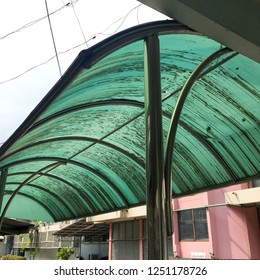 Old polycarbonate roof prevent sunlight and rain.The polycarbonate roof is dilapidated.