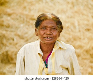 An old poor Bangladeshi woman standing in a place