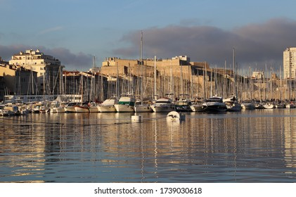 Old port of Marseille with yachts and Fort Saint-Nicolas in Marseille, France in the early morning