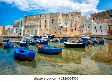 Old port of Monopoli province of Bari, region of Apulia, southern Italy. Boats in the marina of Monopoli.