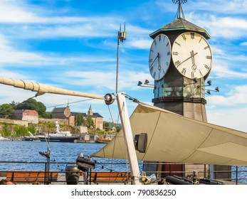 Old Port Oslo. Old Clock Tower at the Aker Brygge promenad and viewing zone to scenic Oslo Fjord. Landmark of Oslo, Norway capital