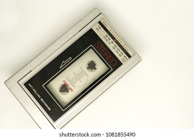 Old portable personal stereo player for play tape cassette and white background.
