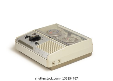 An old portable reel-to-reel mini tape-recorder with microphone, isolated over white background with clipping path.