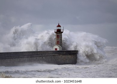 Old Porto lighthouse under heavy storm with huge waves