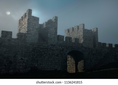 Old portuguese medieval castle in a foggy full moon night