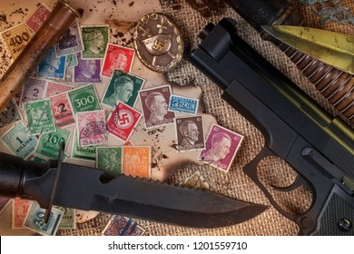 Old postage stamps of the German Third Reich, some with Adolph Hitler or the Nazi swastika.