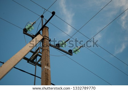 Old Power Line Support on the blue sky background.