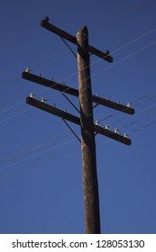 an old power pole with insulators