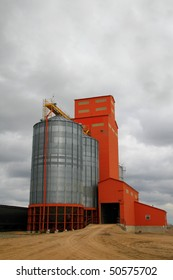 old prairie grain elevator with attached modern steel grain storage bins