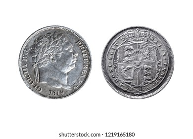 Old pre decimal 1819 George III silver sixpence coin with reverse showing the arms of the UK cut out and isolated on a white background