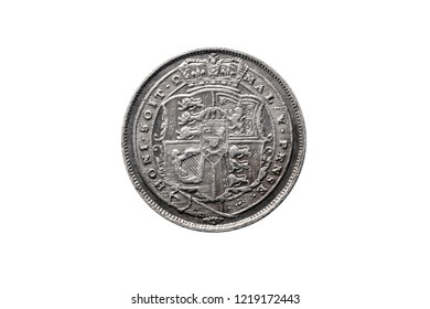 Old pre decimal 1819 George III silver sixpence coin reverse showing the arms of the UK cut out and isolated on a white background
