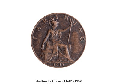 Old pre decimal 1917 George V farthing coin of England UK reverse Britannia cut out and isolated on a white background