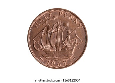 Old pre decimal halfpenny coin of England UK reverse Golden Hind ship cut out and isolated on a white background