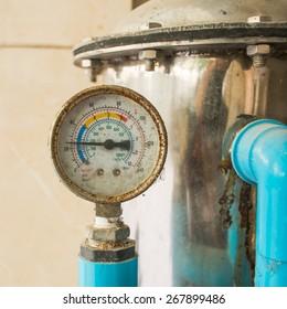 Old pressure gauge and water pump