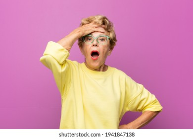 old pretty woman panicking over a forgotten deadline, feeling stressed, having to cover up a mess or mistake